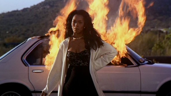 waiting-to-exhale-1995-001-woman-burning-car-in-background